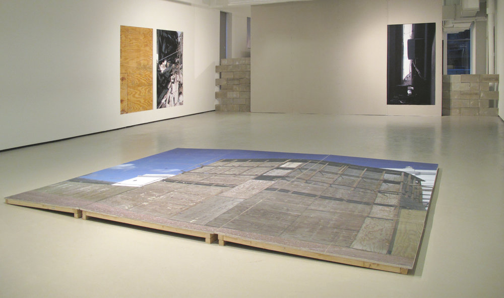 """The Backyard,"" Inkjet prints, cinder blocks, cut-out in walls, and sculpture on floor (prints, drywall, and wood). 2009"