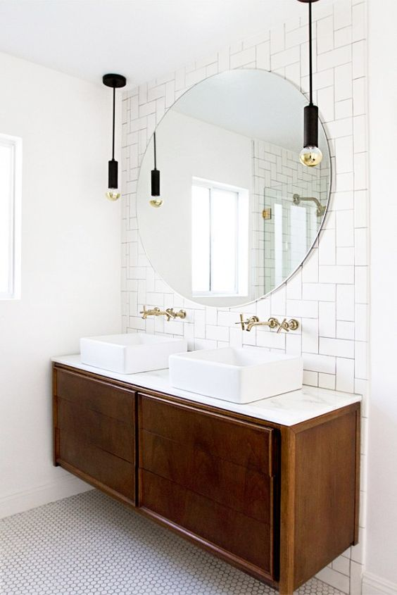 if you've been following my blog, you've probably noticed how much i love white! and a light bathroom is a must for me. our bathroom is on the smaller side, so keeping it bright and light is important to me to open up the space and have it feel larger. what i'm loving about this design is the round mirror placed over the tiled black splash. currently, our bathroom has a standard mirror that takes up the entire wall space; it lacks any real character. i really think this small change would create a world of a difference!