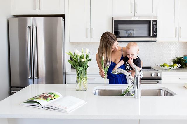 the love i have for this little guy is immeasurable 🖤 thank you to my beautiful and talented friend @nicole.danielle.photography for taking this photo in the new Oakmont Townhomes by @slokkerhomes! They are so beautiful and we feel so lucky to have been apart of this! Also, this kitchen 🙌🏻