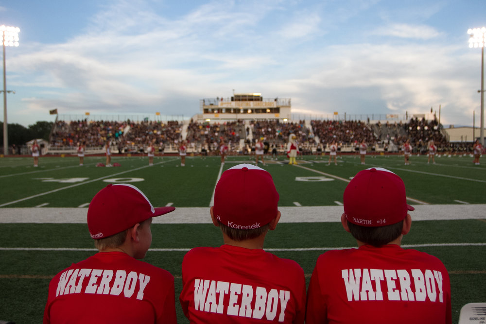 09 Sept. 2016, Port Lavaca, TX – El Campo Waterboys sit on the sideline in preparation for the El Campo Sandcrabs vs. Calhoun Ricebirds football game at Sandcrab Stadium Friday night. El Campo won the game 27-7. (Copyright Bonnie Arbittier).