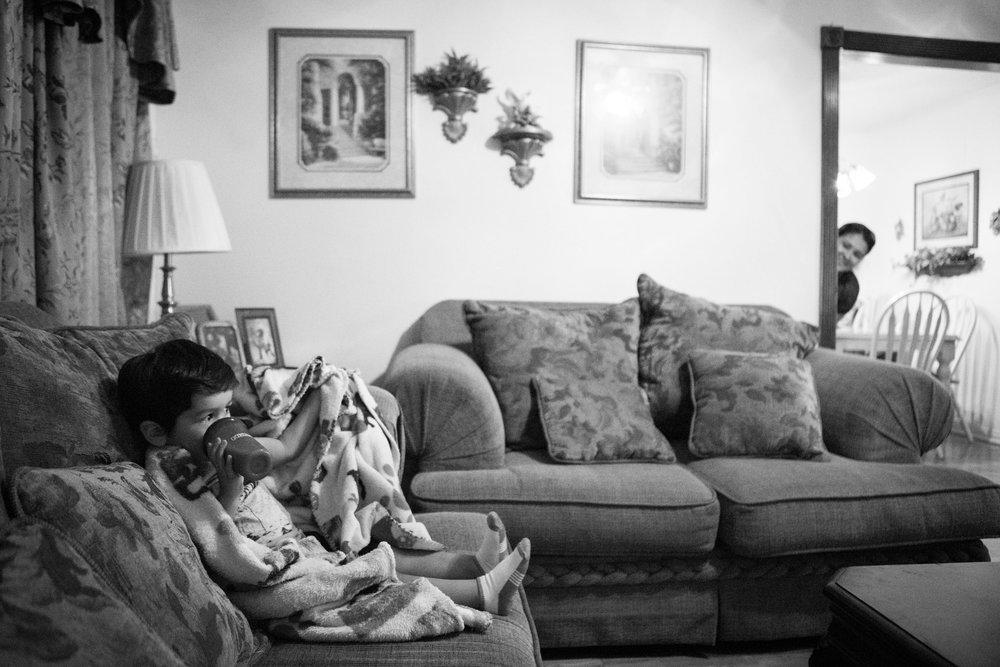 13 July 2017, San Antonio, TX – Alaska Martinez (right) peeks around the corner to check on her son Jimmy, 2, as she makes dinner. (Copyright Bonnie Arbittier)