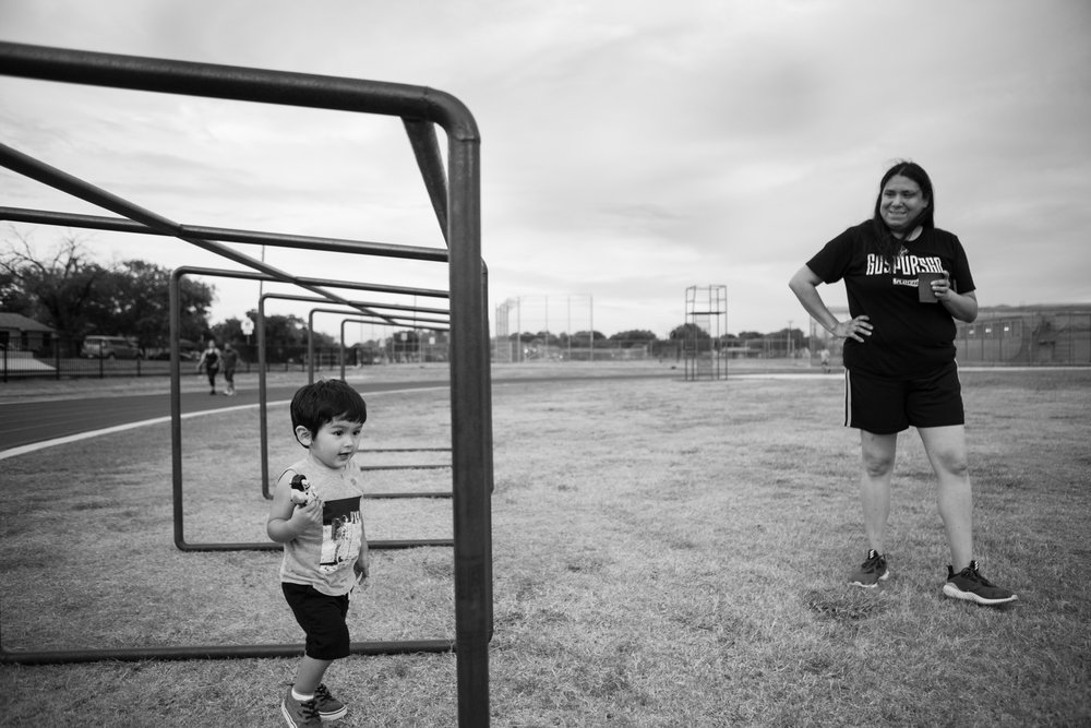 13 July 2017, San Antonio, TX – (From left) Jimmy, 2, and his grandmother Anna Martinez spend time together at the track at Thomas Edison High School. (Copyright Bonnie Arbittier)