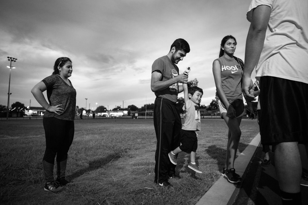 13 July 2017, San Antonio, TX – (From left) Alaska Martinez, Jimmy Martinez, Jimmy, 2, and Mary Martinez prepare to leave after spending an hour running around the track at Thomas Edison High School. (Copyright Bonnie Arbittier)