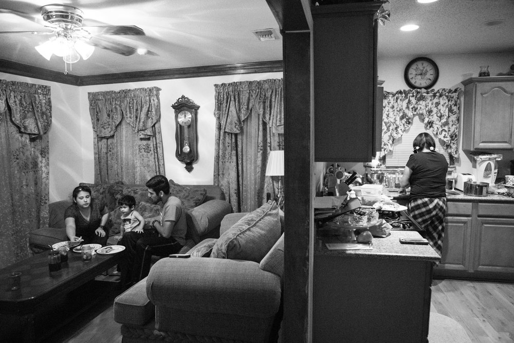 13 July 2017, San Antonio, TX – (From left) Alaska Martinez, Jimmy, 2, and Jimmy Martinez eat their meal in front of the television as Jimmy's grandmother Mary Gallegos cleans up the kitchen. (Copyright Bonnie Arbittier)