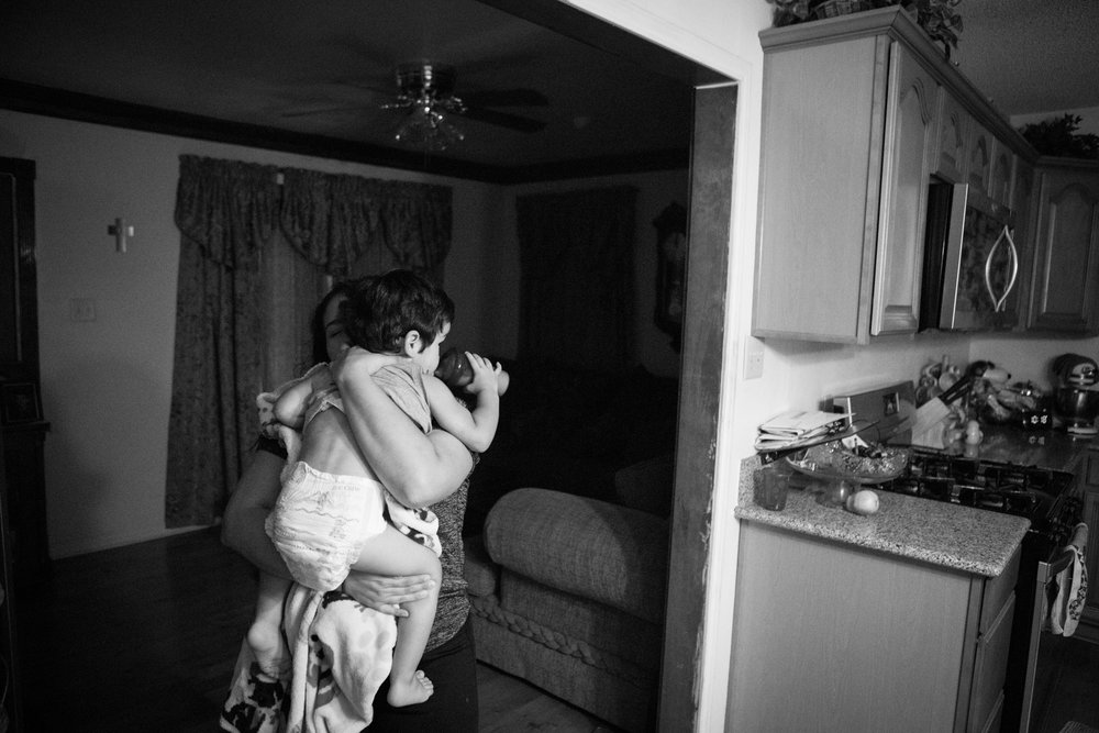 13 July 2017, San Antonio, TX – Alaska Martinez carries Jimmy, 2, from the couch to the bedroom. (Copyright Bonnie Arbittier)