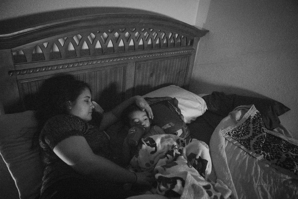 13 July 2017, San Antonio, TX – Alaska Martinez and Jimmy, 2, snuggle in bed in front of the television as they wait for Jimmy Martinez to return from the grocery store to buy Oreos. (Copyright Bonnie Arbittier)