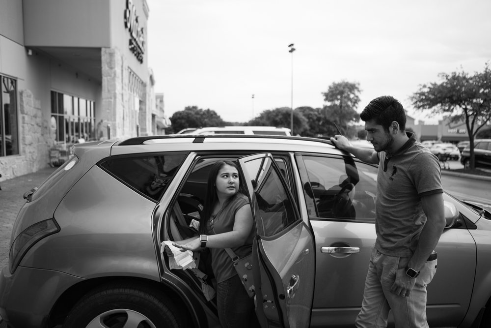 12 July 2017, San Antonio, TX – (From left) Alaska and Jimmy Martinez discuss how to change little Jimmy's diaper in their car outside of Whole Foods. (Copyright Bonnie Arbittier)