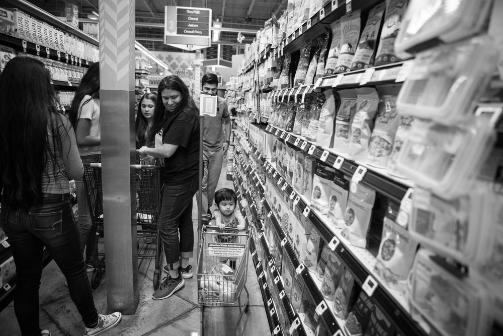 12 July 2017, San Antonio, TX – Jimmy, 2, races through the aisles of Whole Foods as his parents, aunts, and grandmother shop for vegan food as part of a healthy lifestyle. (Copyright Bonnie Arbittier)