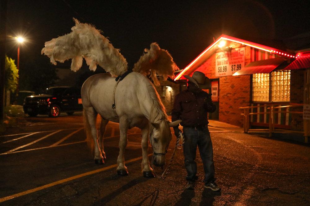 1 July 2017, San Antonio, TX – Jamar McCracken dresses his horse as a pegasus for the PRIDE Bigger Than Texas Parade. (Copyright Bonnie Arbittier)