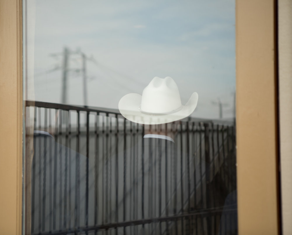 3 April 2018, San Antonio, TX – A man in a cowboy hat watches a Ted Cruz campaign event. (Copyright Bonnie Arbittier)