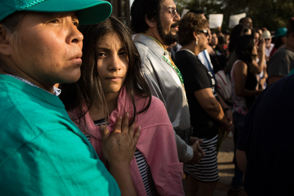 5 September 2017, San Antonio, TX – Juana Arellano and Casandra de Leon hold one another while listening to speakers protest the Trump administration's decision to end DACA. (Copyright Bonnie Arbittier) Institute for Nonprofit News award-winning photograph.