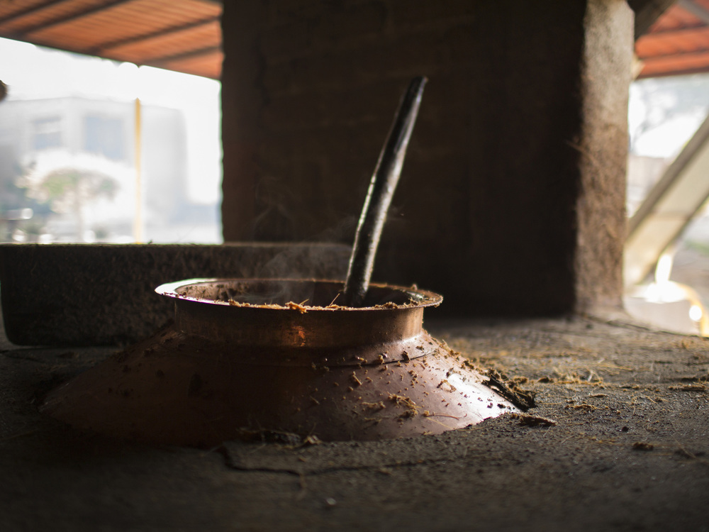 DISTILLING The fermented paste is put into a copper still where it boils and the vapors are condensed into alcohol. Mezcal is distilled twice.
