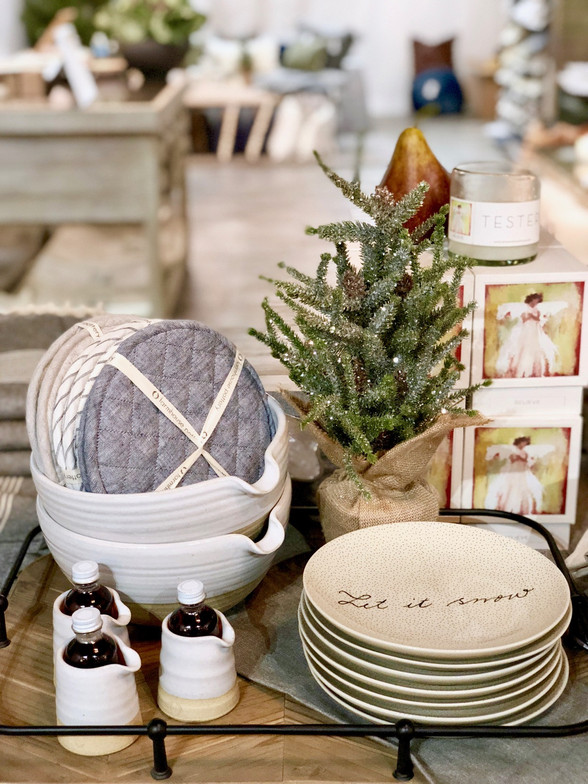 "Petite Silo Pitcher & Vermont Maple Syrup Sets {$36.00} with ""Let It Snow"" Plates {$14.00}, Anne Neilson Luxury Candle Gift Set {$54.00 }, Quilted Linen Oven Mitts {$54.00}, Glittered Tree {$34.00}"