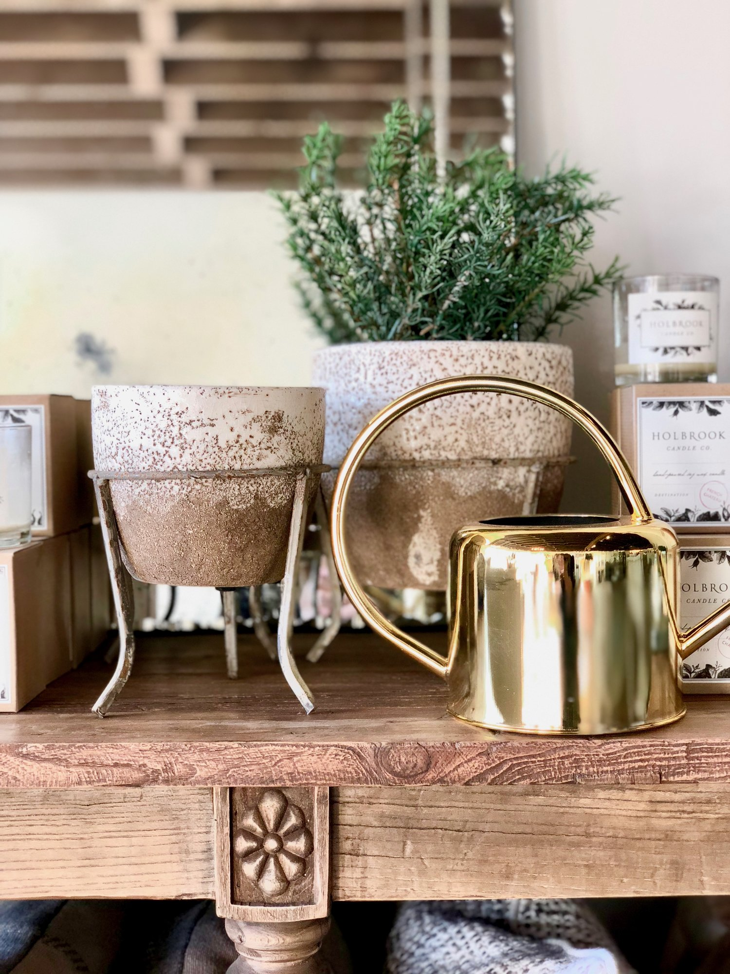 Planters with Stands | $34-48  ;  Brass Watering Can | $36  ;  Faux Rosemary in Pot $70.40
