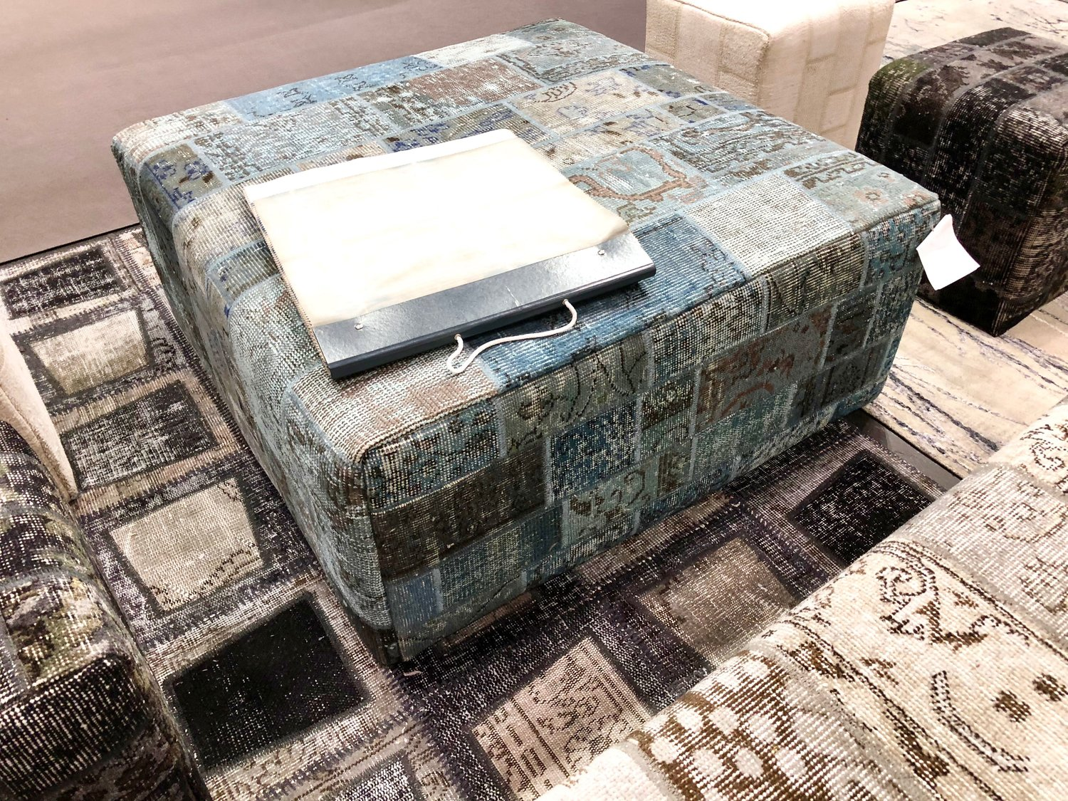 Custom Vintage Patchwork Ottomans -- now available in a variety of colors.  I love the black style.