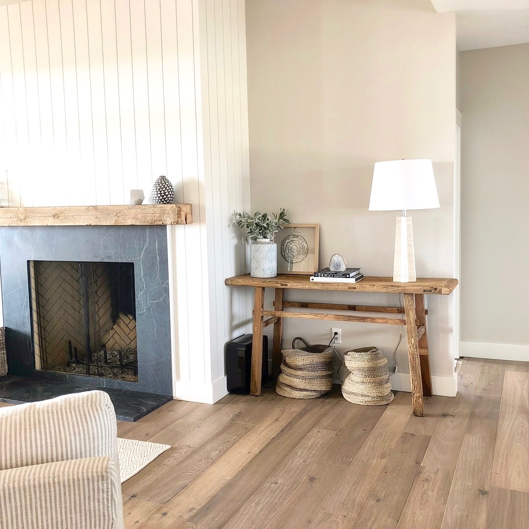 "This client loves the ""California"" modern look -- we selected a reclaimed elm console table to balance the fireplace.  Next step -- art!"