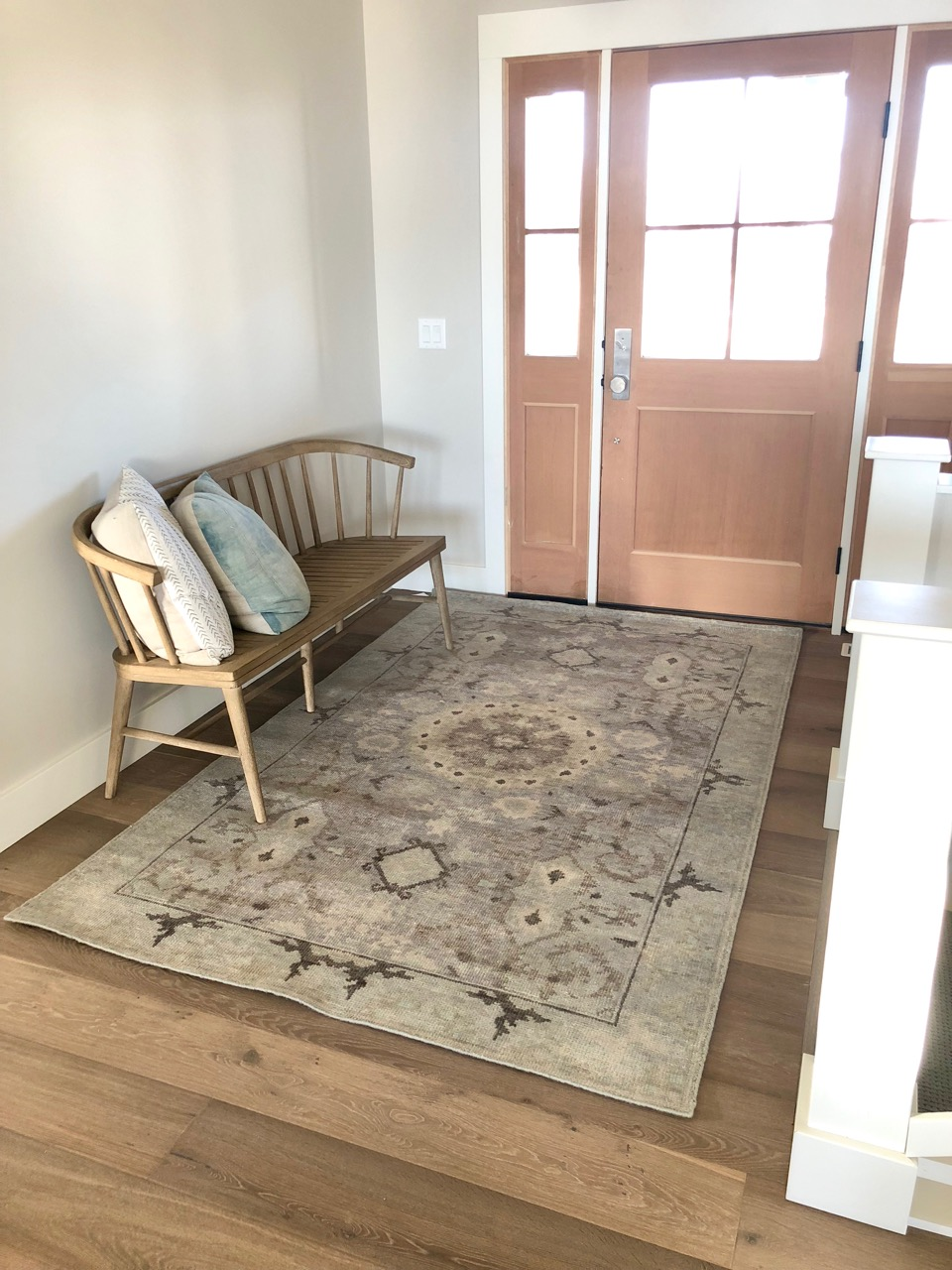 For the entry, a beautiful hand-knotted wool rug that is as durable as it is gorgeous!  A bit of color without distracting from the natural beauty of the wood floors and trim.