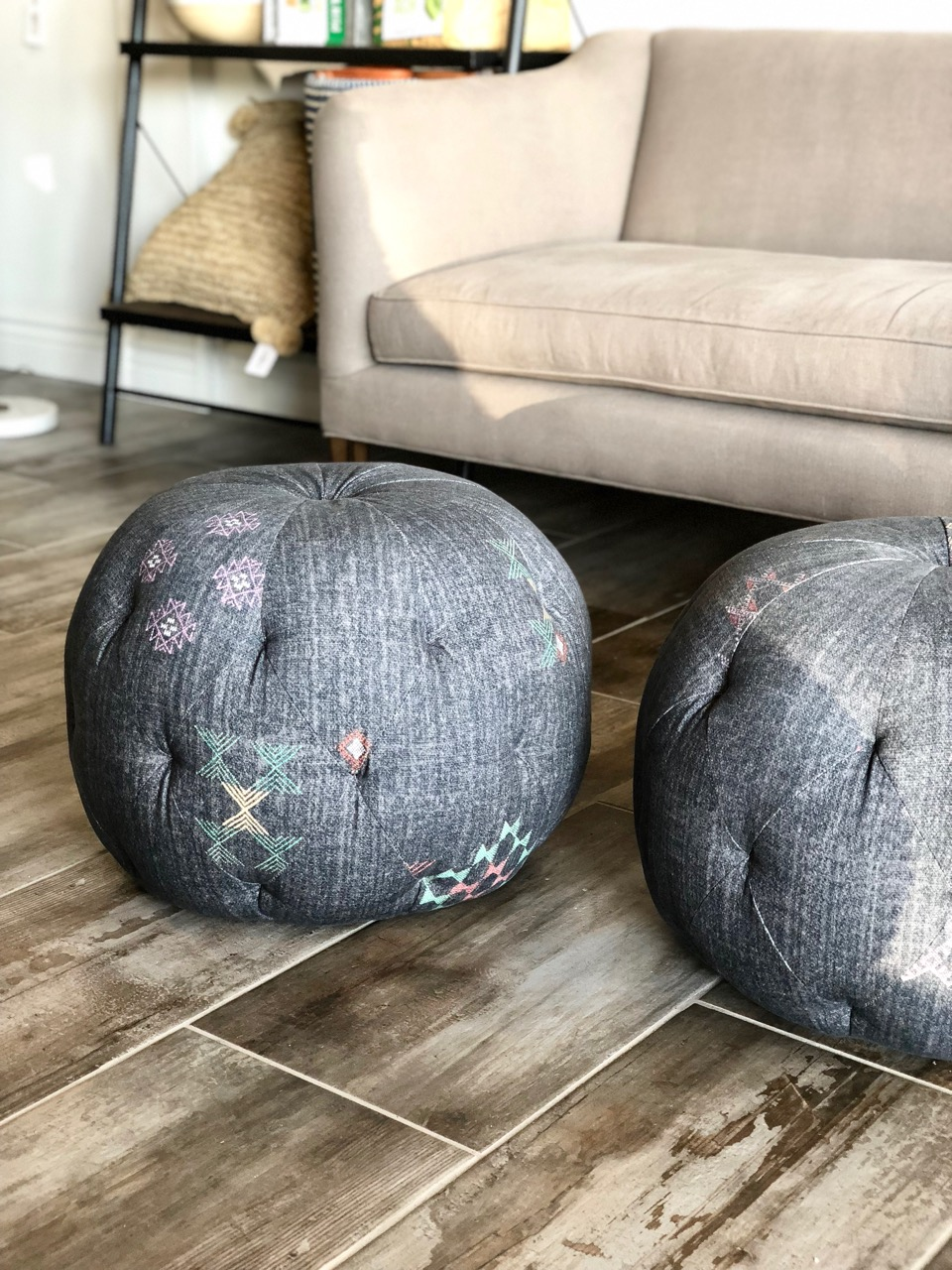 A pair of custom Cisco Brothers poufs arrived in Medina Pepper for a client's living room to serve as additional seating!