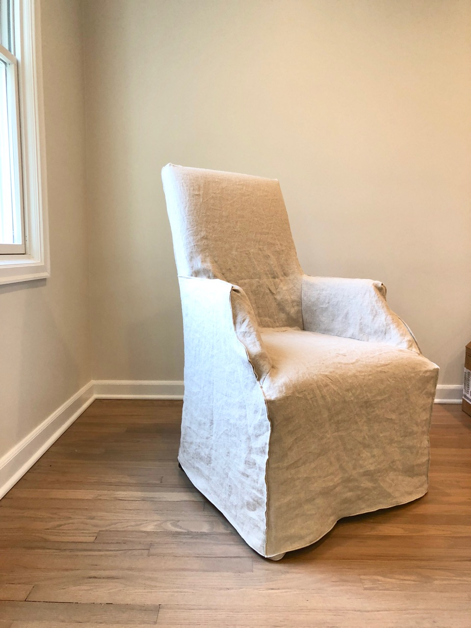 This client needed new life breathed into her Restoration Hardware chairs -- we did a custom slipcover in Otis Oatmeal from Cisco Brother's upholstery fabric line.