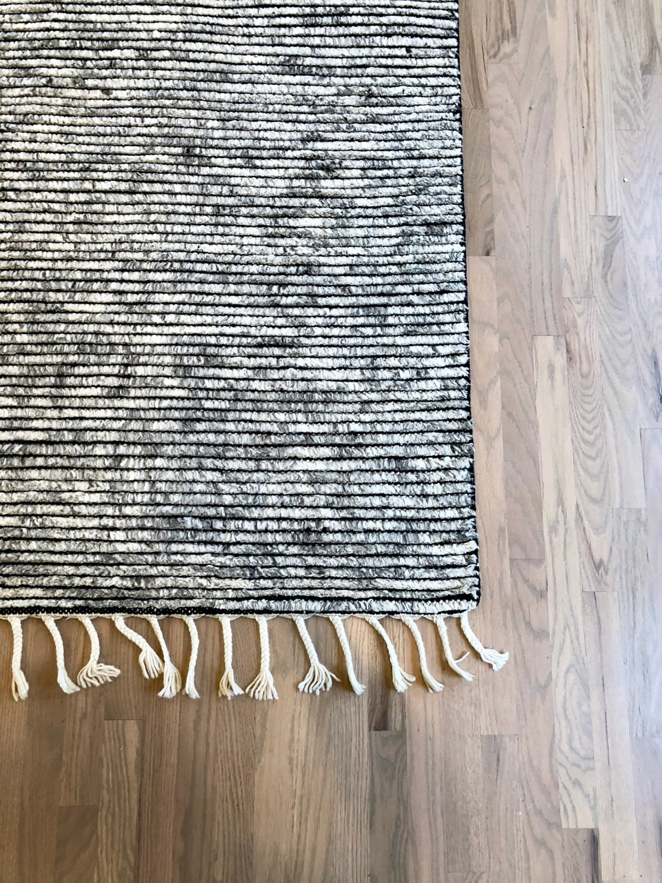 A moroccan style rug adds beautiful texture to my client's newly refinished wood floors.  This is just a sneak peek -- wait until you see the sectional that is coming!