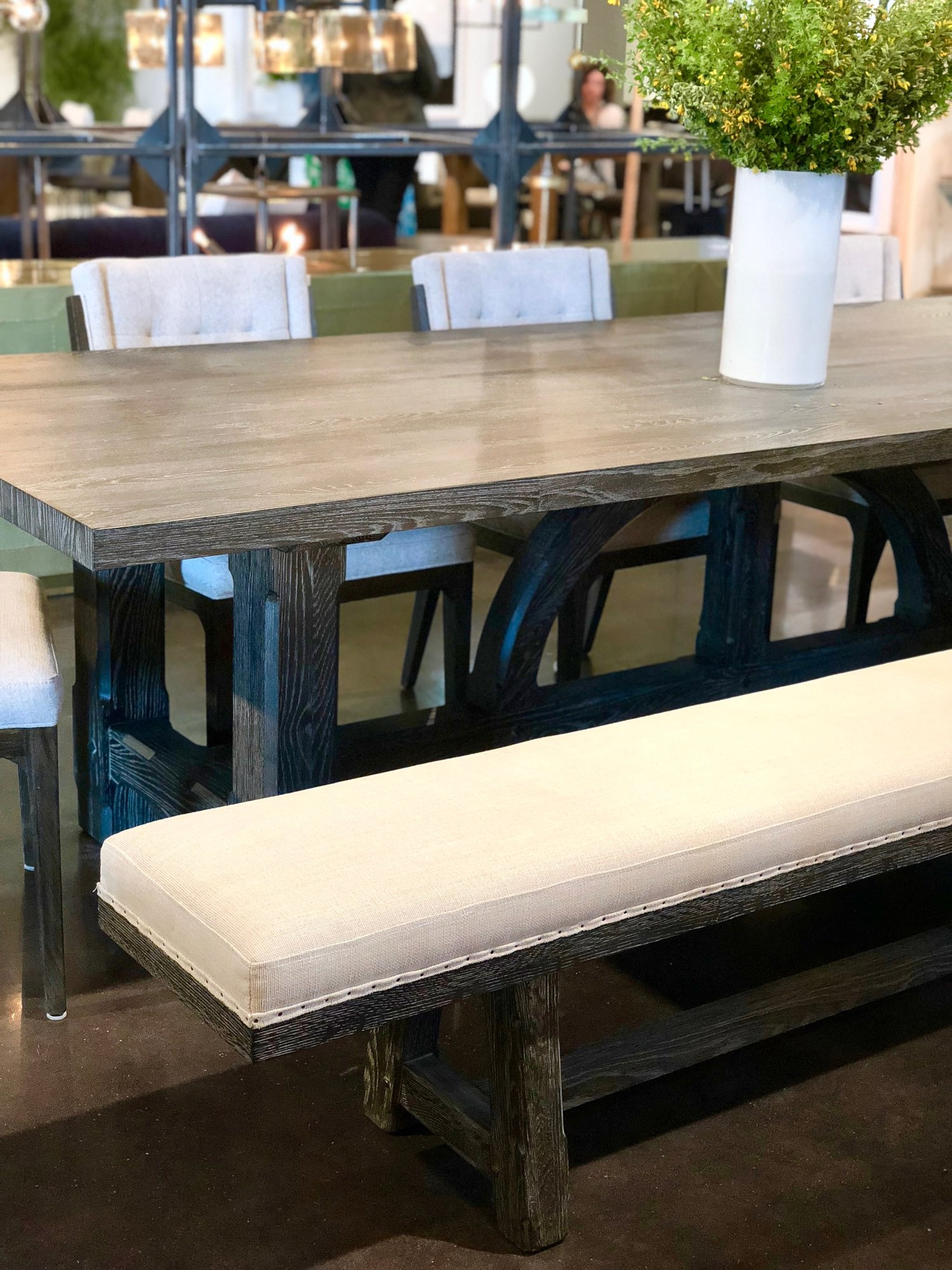 A beautiful 10' black elm veneer dining table designed by Van Thiel -- the base is stunning.  Pair with a matching dining bench or flank with streamlined dining chairs.  Sits 10-12 people!