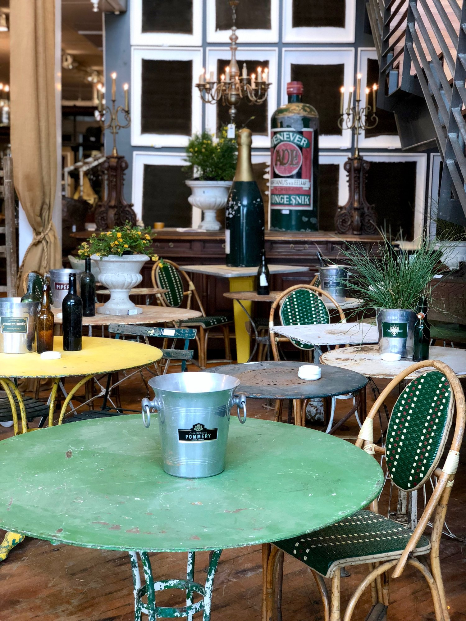 Bistro inspiration overload -- the planters on tables, green chairs, endless character -- why has color become such a naughty word in interiors?  I miss it!  Let's all agree to bring back color.