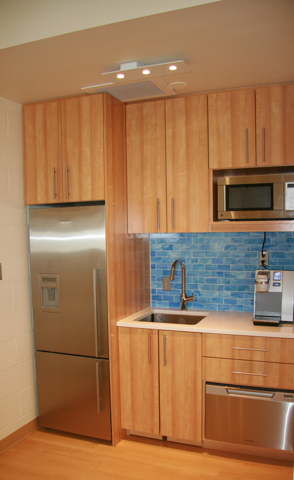 Waterworks backsplash tile, Silestone countertop, and stainless steel appliances make the kitchen a favorite spot for faculty and parents.