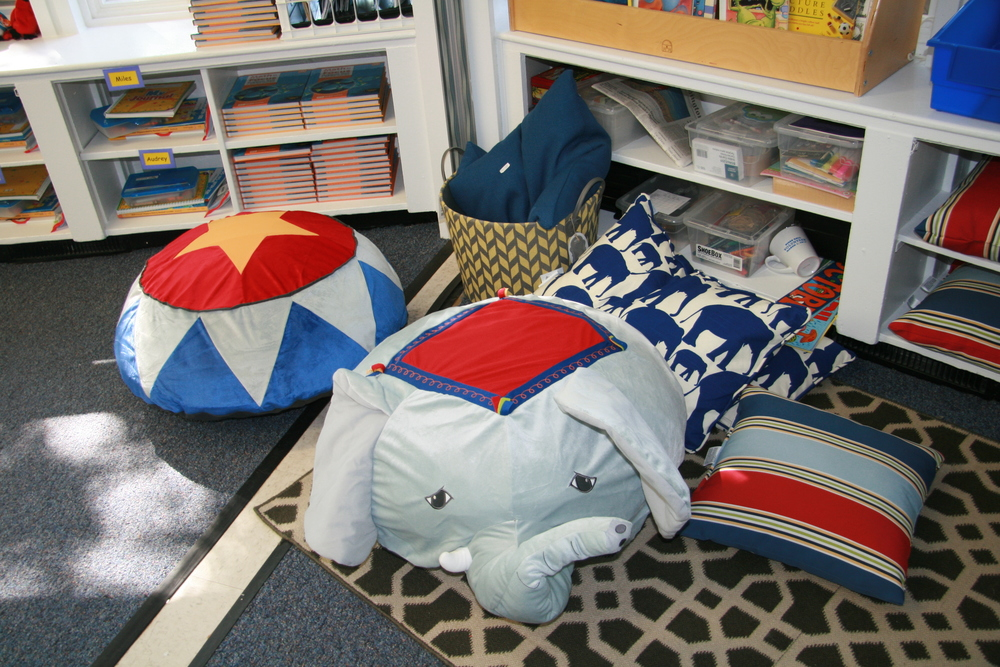 Pillows from IKEA make a warm and inviting spot to read in the Kindergarten Classroom.
