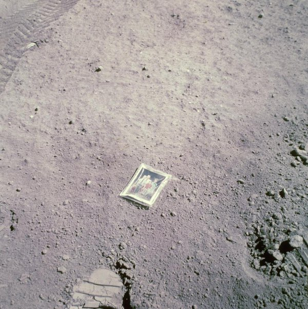 Apollo 16 astronaut Charles Duke leaves a photo of his family on the moon in 1972 .