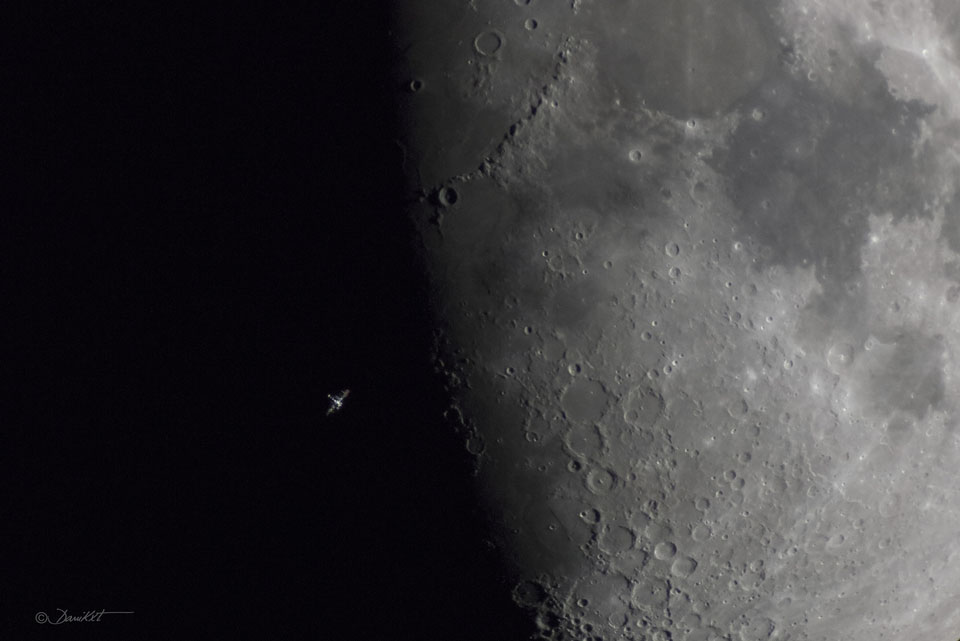 International Space Station in front of the moon