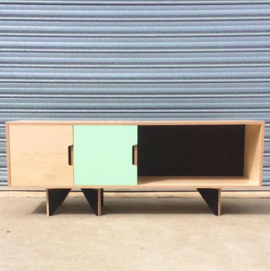 Custom plywood sideboard with black film ply rocket legs, custom pull details and dark grey acoustic backing.