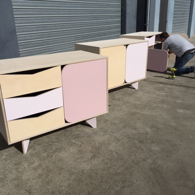 Custom set of sideboards made with custom colors for a baby girl's wardrobe.