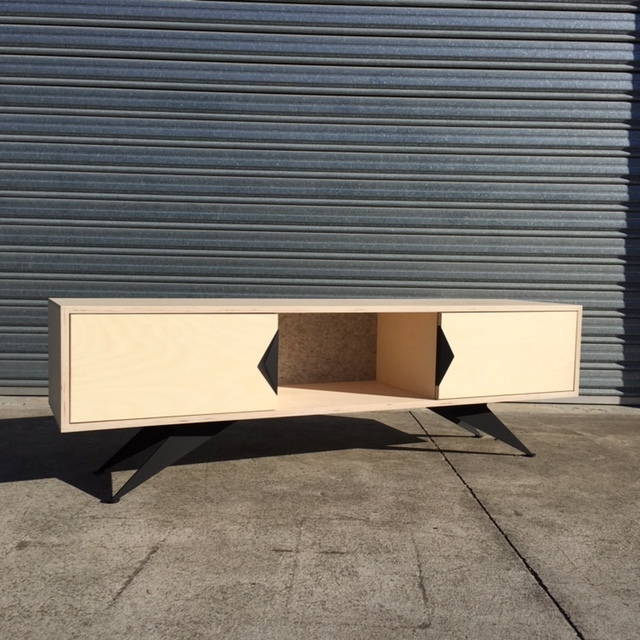 Custom sideboard with a combination of black film and natural plywood, custom handle detail and plywood rocket legs.