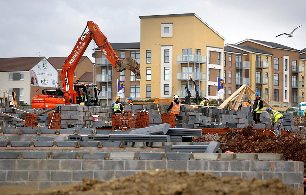 BRISTOL, UNITED KINGDOM - MARCH 18:  Construction workers continue to build new houses on a housing development on March 18, 2014 in Bristol, England.  A number of housebuilders are now constructing more homes this year than they did during the 2007 market peak, thanks to overseas investment and the government's Help to Buy scheme, which has been extended until 2020, boosting the property market and speeding up the number of new homes being built.  (Photo by Matt Cardy/Getty Images)