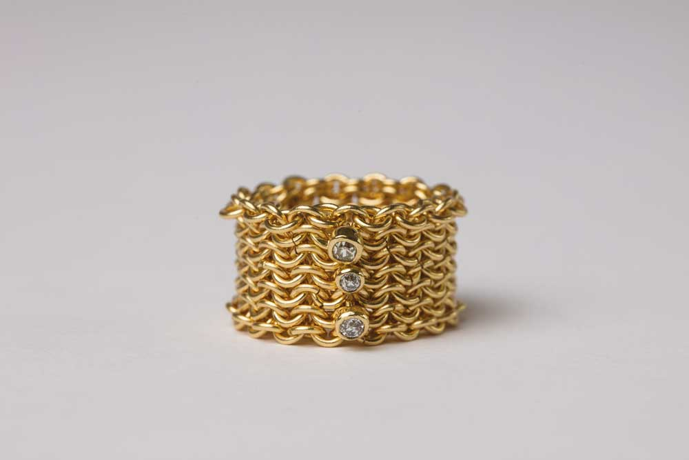 18 carat gold basketweave ring with diamonds