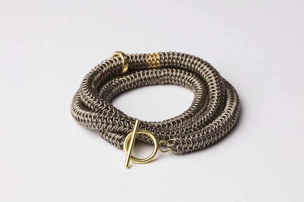 Titanium, 18ct gold and diamond wrap around bracelet