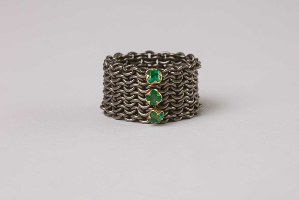 Titanium, 18ct gold and emerald ring