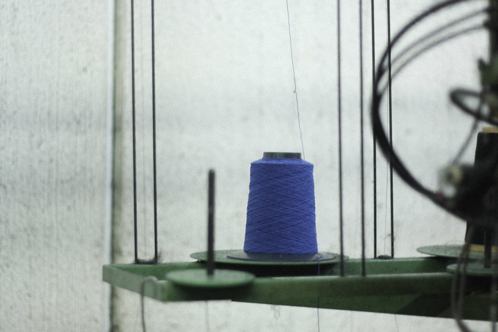 A Woven Plane – sustainable fashion for women, socks made in Italy – visiting the Italian factory where our socks are made – spool of indigo yarn