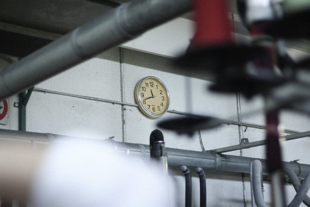A Woven Plane – sustainable fashion for women, socks made in Italy – visiting the Italian factory where our socks are made – clock on factory wall
