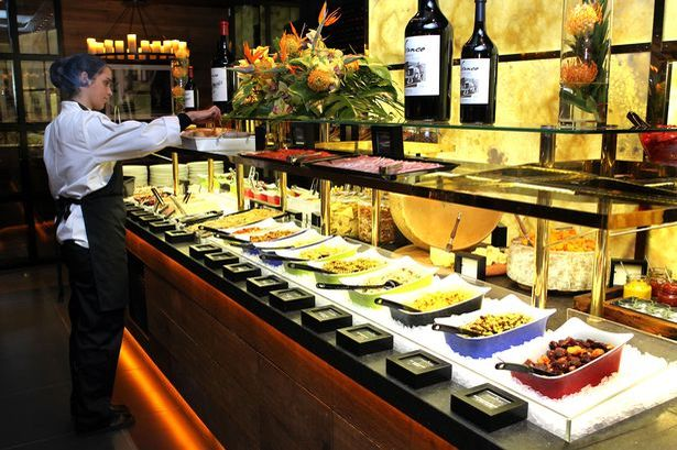A typical presentation of foods one might see at an all you can eat buffet.