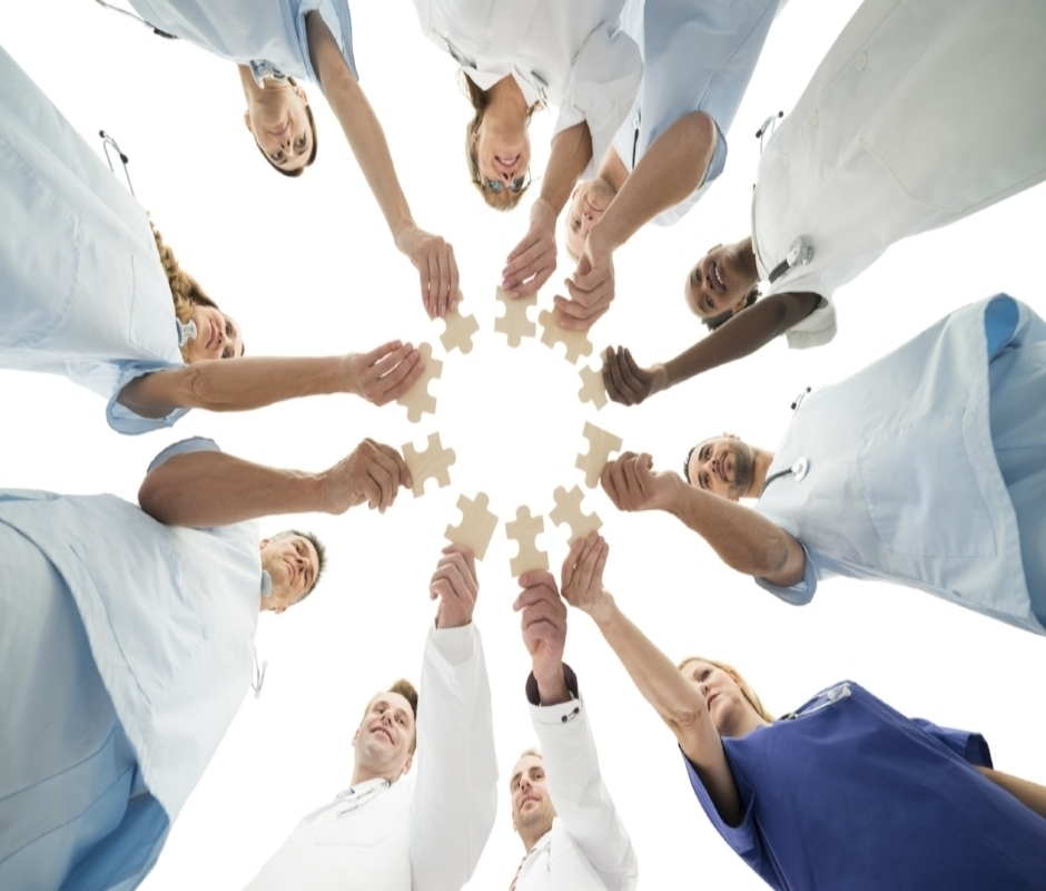 Medical-Team-Joining-Jigsaw-Pieces-In-Huddle-000099994611_Large.jpg