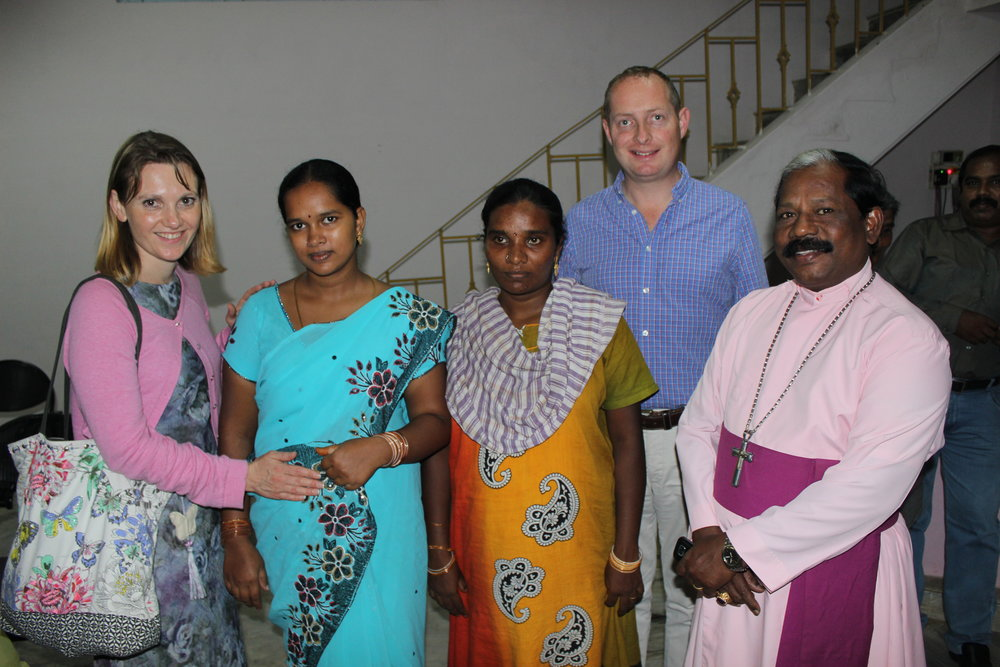 Left to Right: Sherry Secker, local pregnant women coming for medical care, Rev. Richard Lloyd, Archbishop Samuel