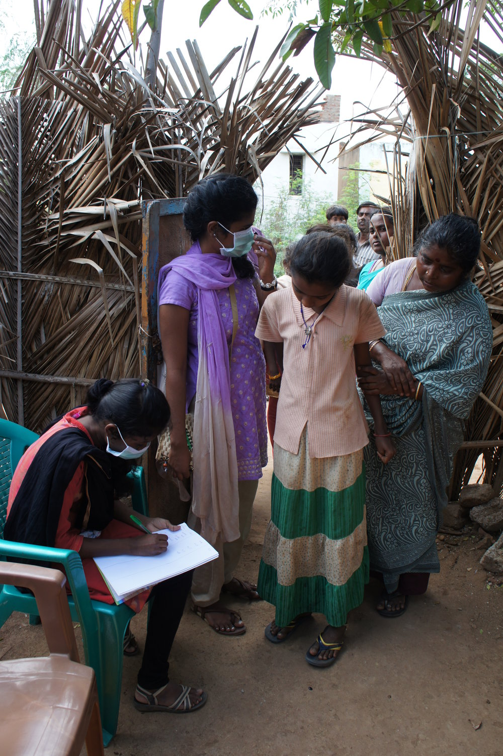 Bible College students - Thamaria and Meena at the gate registering patients