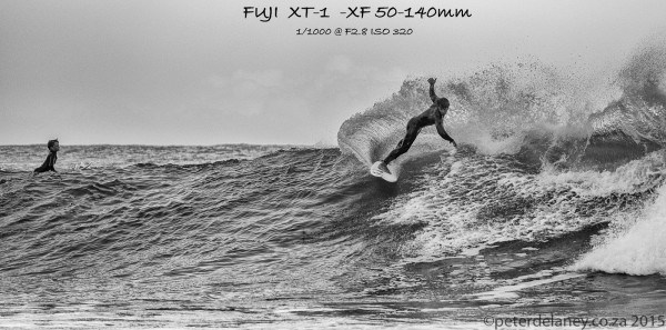 FUJI XF 50-140MM review, black and white photo of a surfer riding a wave