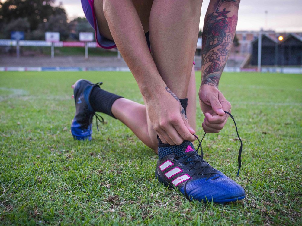 Gemma wears own Adidas football boots.