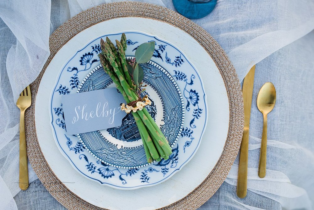 Yes, that is fresh asparagus!Thank you to  Cru Vintage Rentals  for the flat ware and plates and  Cotton Wood Prints  for the place cards. Photo Credit:  Jessica Elle Photography