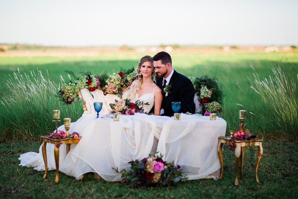 DeVinnie's Paradise Floral  worked closely with Nancy to create the beautiful floral pieces. The flowers DeVinnie's team selected were breathtaking!  The fresh fruit and bold colors complimented the lush green fields. (and yes...those are all fresh fruits on the side tables). We are still swooning over the love seat and vintage rentals from  Cru Vintage Rentals ! Photo Credit:  Jessica Elle Photography