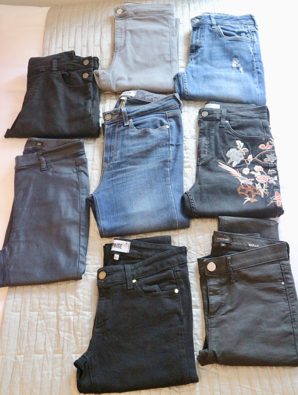(Left) Black Dungarees (Flea Market Buy) and Navy Next Pleather Jeggings  (Centre) Grey Topshop Joni Jeans, Blue Paige Jeans, Black Paige Jeans  (Right) Blue Topshop Boyfriend Jeans, Black Embroidered Topshop Jeans, Black Molly Coated River Island Jeans