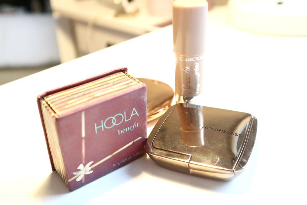 Front:  Hoola Bronzer by Benefit, Hourglass Ambient Lighting Blush in shade, Mood Exposure.    Back: (just seen) Charlotte Tilbury Airbrush Flawless Finish Powder in shade, 1 Fair and Collection Speedy Highlighter in shade, 01 Pearl Sheen.