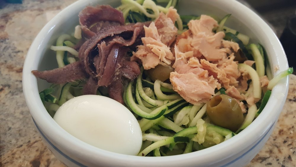 Even better-- zucchini noodles with Tuna, anchovies, hard boiled egg and olives